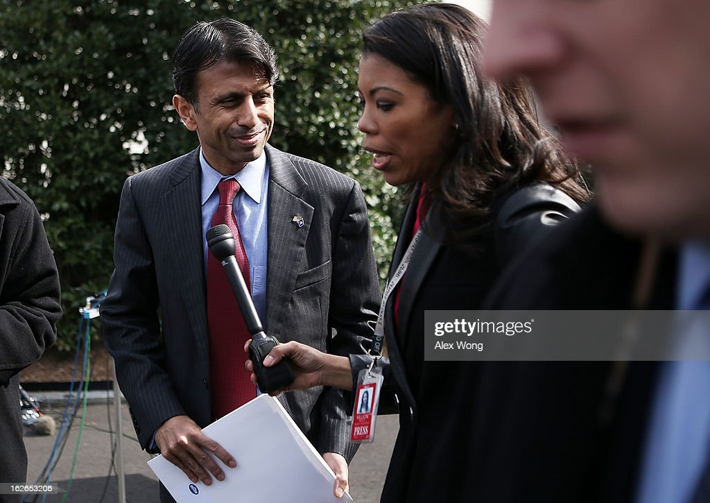 Louisiana Gov. <a gi-track='captionPersonalityLinkClicked' href=/galleries/search?phrase=Bobby+Jindal&family=editorial&specificpeople=2249969 ng-click='$event.stopPropagation()'>Bobby Jindal</a> (L) speaks to members of the press after a State Dining Room meeting with U.S. President Barack Obama at the White House February 25, 2013 in Washington, DC. Governors from across the nation were in Washington for the 2013 National Governors Association Winter Meeting.