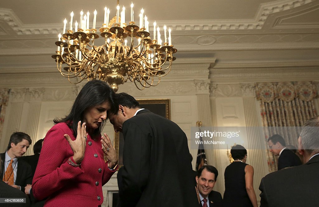 Louisiana Gov Bobby Jindal talks with South Carolina Gov Nikki Haley before US President Barack Obama addressed members of the National Governors...