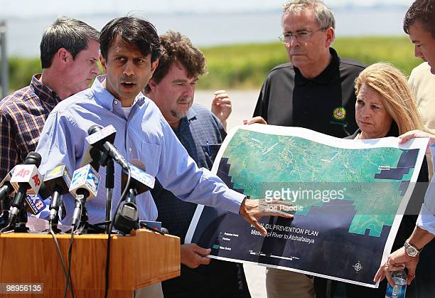 Louisiana Governor Bobby Jindal points to a map showing the areas that might be affected by BP's massive oil spill as he meets with the media on May...