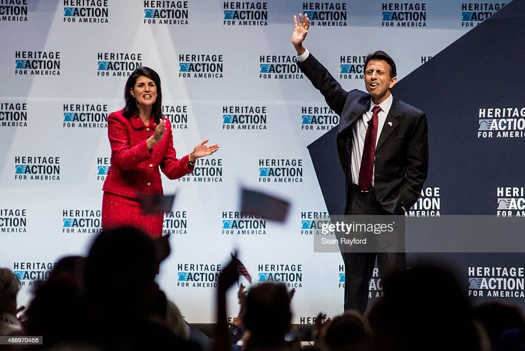 Louisiana Governor <a gi-track='captionPersonalityLinkClicked' href=/galleries/search?phrase=Bobby+Jindal&family=editorial&specificpeople=2249969 ng-click='$event.stopPropagation()'>Bobby Jindal</a> receives applause from South Carolina Governor <a gi-track='captionPersonalityLinkClicked' href=/galleries/search?phrase=Nikki+Haley+-+Governatore&family=editorial&specificpeople=6974701 ng-click='$event.stopPropagation()'>Nikki Haley</a> at the Heritage Action Presidential Candidate Forum September 18, 2015 in Greenville, South Carolina. Ten republican candidates were each given 25 minutes to talk to the crowd at the Bons Secours Wellness Arena in the upstate of South Carolina.