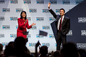 Louisiana Governor Bobby Jindal receives applause from South Carolina Governor Nikki Haley at the Heritage Action Presidential Candidate Forum...
