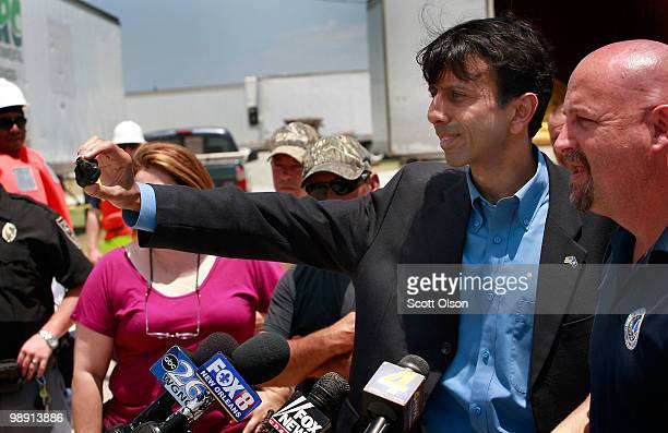Louisiana Governor Bobby Jindal shows off a ball of tarlike substance said to be oil from the massive oil spill off the Louisiana coast during a...