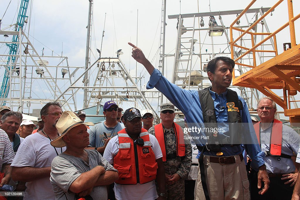 Louisiana Governor <a gi-track='captionPersonalityLinkClicked' href=/galleries/search?phrase=Bobby+Jindal&family=editorial&specificpeople=2249969 ng-click='$event.stopPropagation()'>Bobby Jindal</a> speaks with workers, mainly fisherman, involved in the clean-up effort of the BP oil spill on a command post boat in Barataria Bay on June 15, 2010 off of Grand Isle, Louisiana. The BP spill has been called the largest environmental disaster in American history. U.S. government scientists have estimated that the flow rate of oil gushing out of a ruptured Gulf of Mexico oil well may be as high 40,000 barrels per day. Following his fourth trip to the Gulf on Monday, President Barack Obama will address the nation in an Oval Office speech today on the situation in the Gulf.
