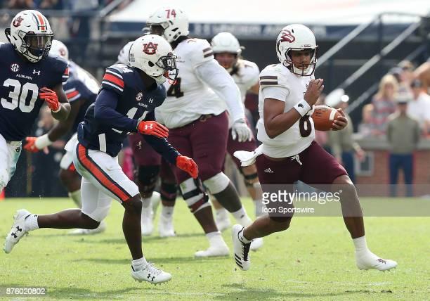 Louisiana Monroe Warhawks quarterback Caleb Evans runs for a first down during a football game between the Auburn Tigers and the LouisianaMonroe...