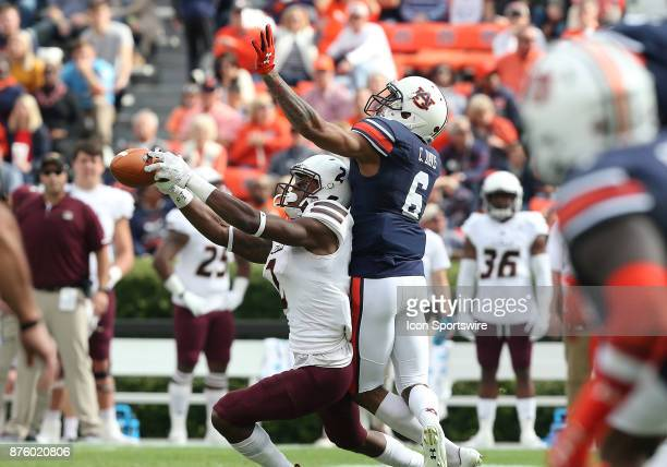 Louisiana Monroe Warhawks wide receiver RJ Turner attempts to haul in a reception with Auburn Tigers defensive back Carlton Davis defending during a...