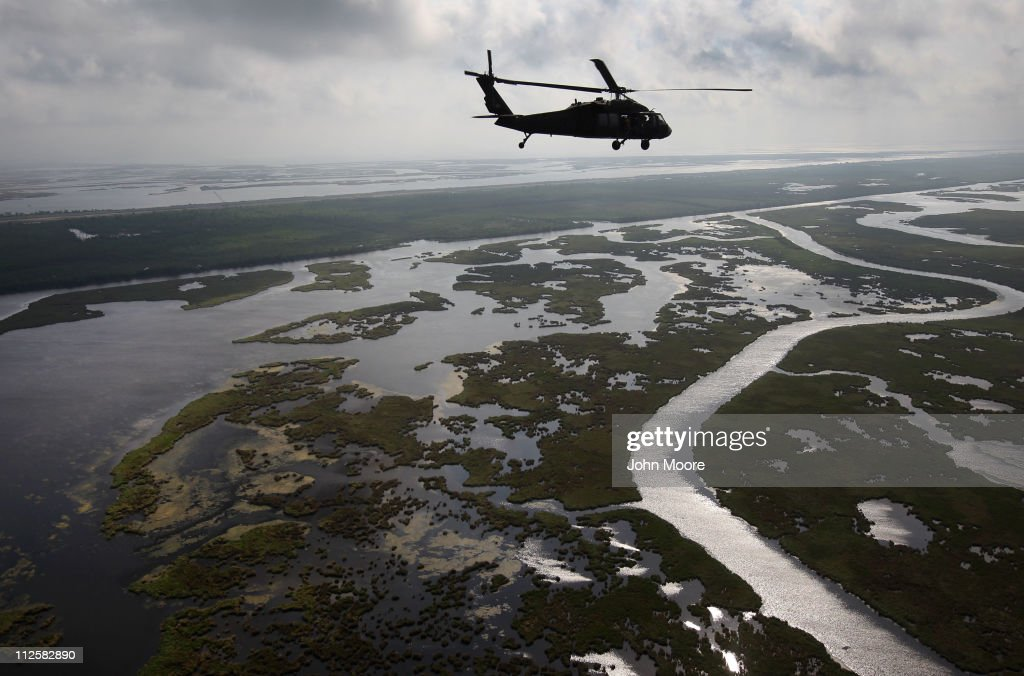 A Louisiana National Guard blackhawk flies over marshland on April 19, 2011 in route to Middle Ground in southern Louisiana. A year after the BP oil spill coated Gulf coast marshes and beaches, BP claims that most of the oil has been removed. Louisiana Wildlife and Fisheries says, however, that much of the cleaning has been superficial, as the oil has seeped into the soil, killing marshes and further eroding the state's damaged delta ecosystem.