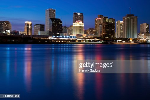 USA, Louisiana, New Orleans, Mississippi River and skyline illuminated at night