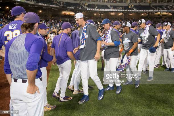 Louisiana State University exchange handshakes the University of Florida after game two of the Division I Men's Baseball Championship held at TD...