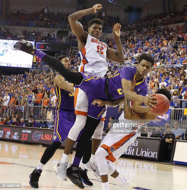 Louisiana Stat's Antonio Blakeney is fouled hard by Florida's John Egbunu at the Stephen C O'Connell Center in Gainesville Fla on Saturday Jan 9 2016...