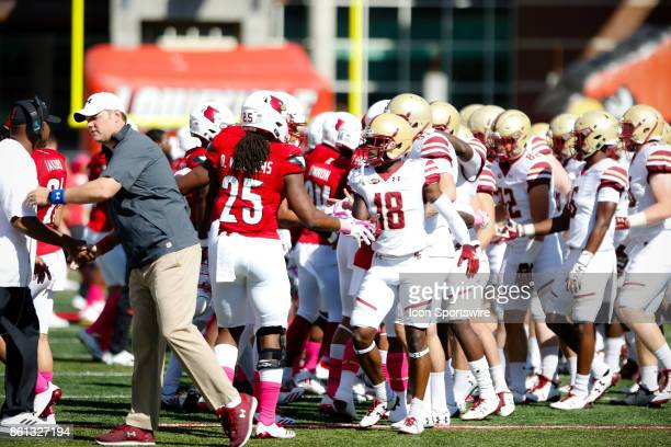 Louisville Cardinals and Boston College Eagles shake hands for ACC sportsmanship awareness week before the game between the Louisville Cardinals and...