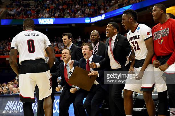 Louisville Cardinals bench reacts to a shot by Terry Rozier of the Louisville Cardinals in the second half of the game against the North Carolina...