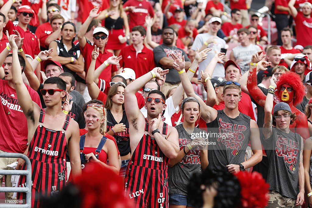 Louisville Cardinals fans cheer for their team against the Ohio Bobcats during the game at Papa John's Cardinal Stadium on September 1, 2013 in Louisville, Kentucky. Louisville won 49-7.