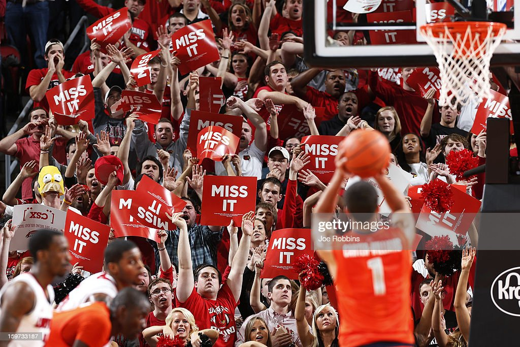 Louisville Cardinals fans try to distract a free throw attempt by Michael Carter-Williams #1 of the Syracuse Orange during the game at KFC Yum! Center on January 19, 2013 in Louisville, Kentucky. Syracuse defeated Louisville 70-68.