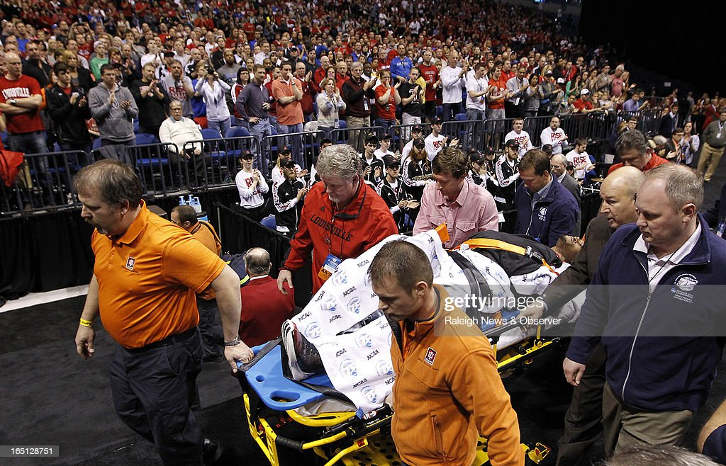 Louisville Cardinals guard Kevin Ware is taken of the court on a stretcher after breaking his leg in the first half of play of the NCAA Tournament at...
