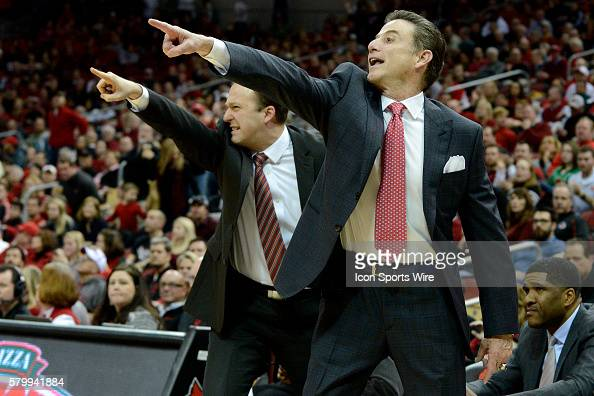 Louisville Cardinals head coach Rick Pitino and assistant coach Mike Balado yell instructions to their team during the college basketball game...