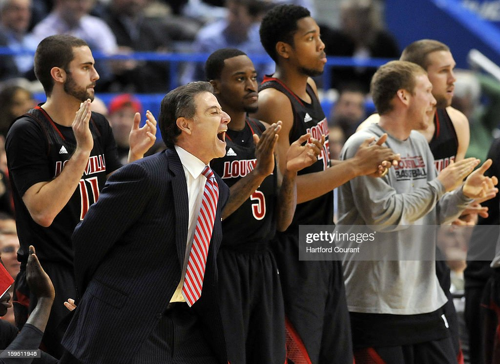 Louisville Cardinals head coach Rick Pitino cheers on his players as they begin to pull away from the Connecticut Huskies at the XL Center on Monday, January 14, 2013, in Hartford, Connecticut.