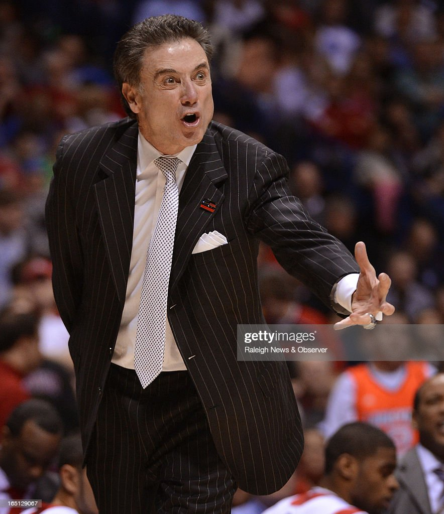 Louisville Cardinals head coach Rick Pitino screams at his players early in the first half of play during the NCAA Tournament at Lucas Oil Stadium in Indianapolis, Indiana, Sunday, March 31, 2013. Louisville defeated Duke, 85-63.