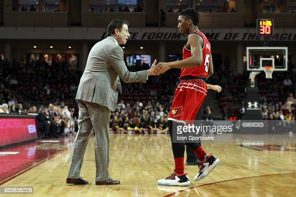Louisville Cardinals head coach Rick Pitino speaks with Louisville Cardinals guard Donovan Mitchell during the second half of a college basketball...