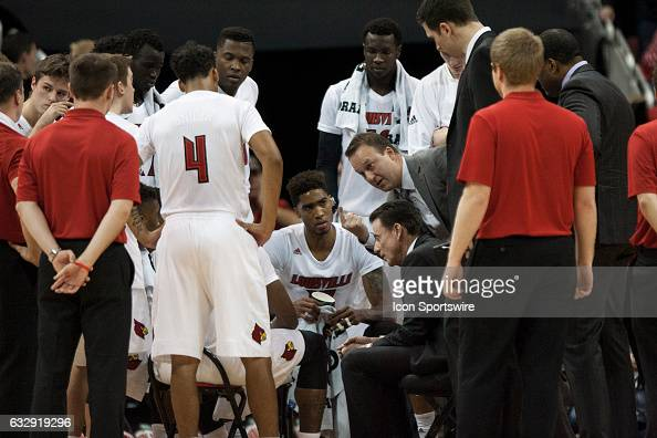 Louisville Cardinals head coach Rick Pitino talks to team during a time out during the first half on December 21 2016 at the KFC Yum Center in...