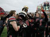 Louisville Cardinals hold the Governor's Cup after the 4440 win over the Kentucky Wildcats at Papa John's Cardinal Stadium on November 29 2014 in...