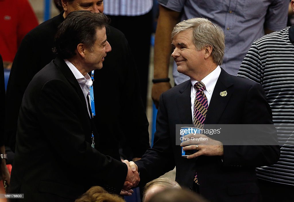 Louisville Cardinals men's head coach Rich Pitino (L) shakes hands with NCAA President Mark Emmert prior to the 2013 NCAA Women's Final Four Championship between the Connecticut Huskies and the Louisville Cardinals at New Orleans Arena on April 9, 2013 in New Orleans, Louisiana.