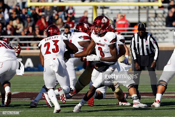 Louisville Cardinals quarterback Lamar Jackson hands off to Louisville Cardinals running back Brandon Radcliff on Saturday November 5 2016 at Alumni...