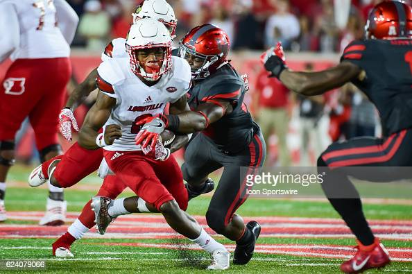 Louisville Cardinals quarterback Lamar Jackson is tackled from behind by Houston Cougars cornerback Brandon Wilson during the NCAA football game...