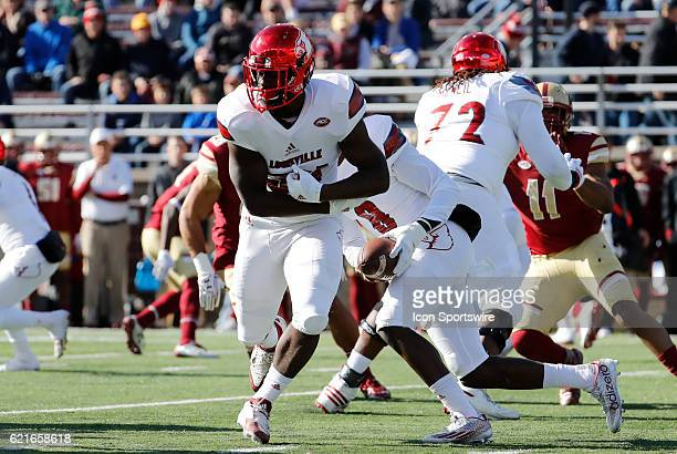 Louisville Cardinals running back Brandon Radcliff sells the fake hand off as Louisville Cardinals quarterback Lamar Jackson takes off for his first...