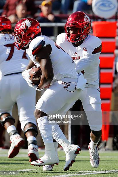 Louisville Cardinals running back Brandon Radcliff takes the hand off from Louisville Cardinals quarterback Lamar Jackson during an ACC Division 1...