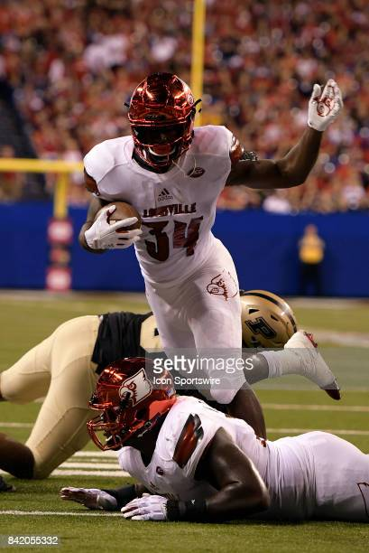 Louisville Cardinals running back Jeremy Smith hurdles a player during the college football game between the Louisville Cardinals and the Purdue...