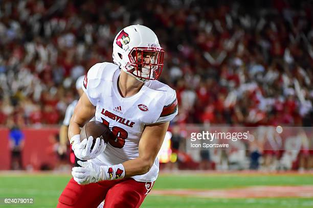 Louisville Cardinals tight end Cole Hikutini catches a second half touchdown pass in the flat during the NCAA football game between the Louisville...