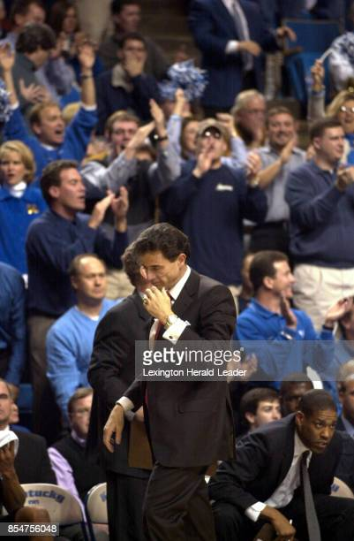 Louisville coach Rick Pitino walks the sideline as Kentucky fans cheer in the background as No 6 Kentucky beat Louisville 8262 on Saturday Dec 29...