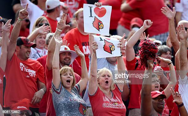 Louisville fans react after a Louisville Cardinals touchdown during the game against the Florida State Seminoles at Papa John's Cardinal Stadium on...