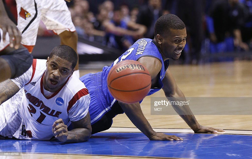 Louisville forward Chane Behanan (21) and Duke guard Tyler Thornton (3) battle for this loose ball in second half action in the NCAA regional final game on Sunday, March 31, 2013, in Indianapolis, Indiana. Louisville won the game 85-63. (Sam Riche/MCT via Getty Images)in the NCAA regional final game on Sunday, March 31, 2013, in Indianapolis, Indiana. Louisville won the game 85-63.