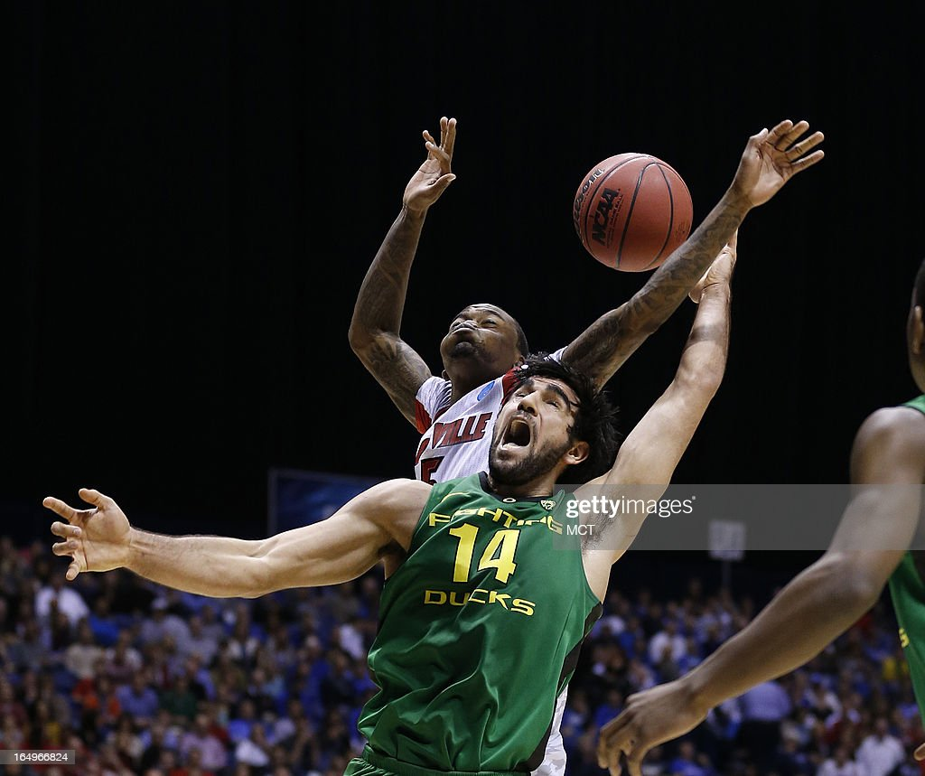 Louisville guard Kevin Ware blocks Oregon forward Arsalan Kazemi in second half action in their NCAA fourth round game on Friday March 29 in...