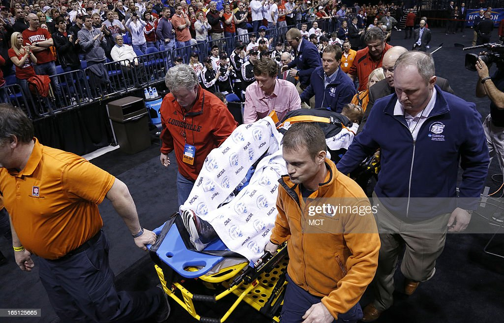 Louisville guard Kevin Ware is taken from the floor after breaking his leg in first half action in the NCAA regional final game on Sunday March 31 in...