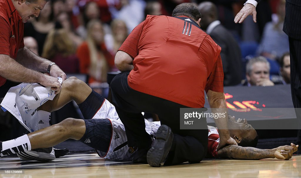 Louisville guard Kevin Ware screams in pain after breaking his right leg in first half action in the NCAA regional final game on Sunday March 31 in...