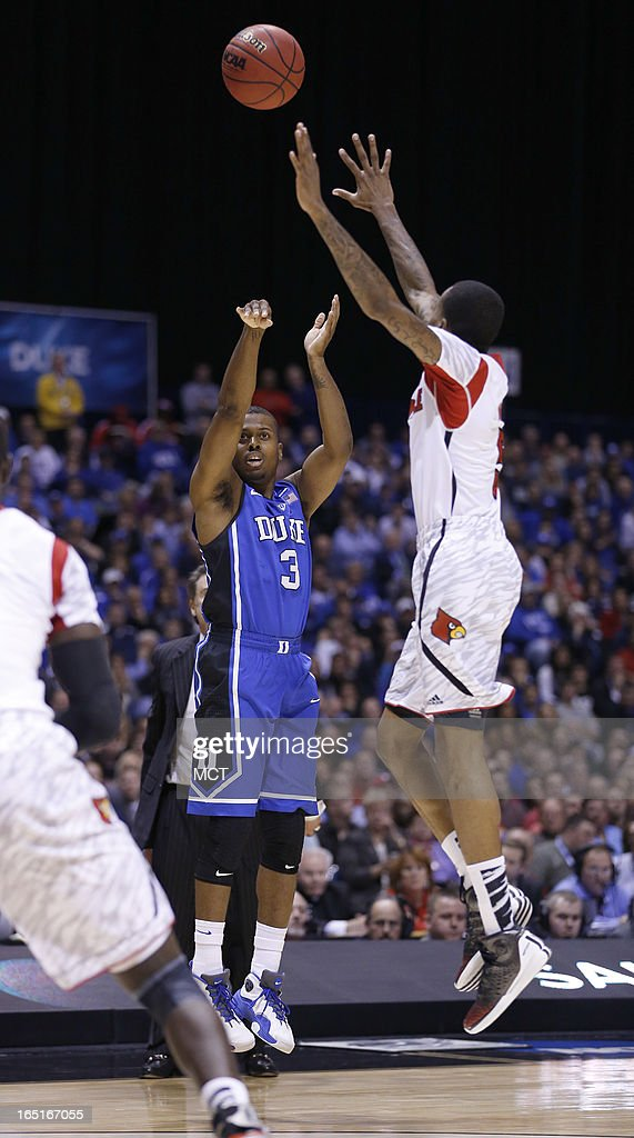Louisville guard Kevin Ware tries to block Duke guard Tyler Thornton in first half action It was on this play that Ware landed on and broke his right...