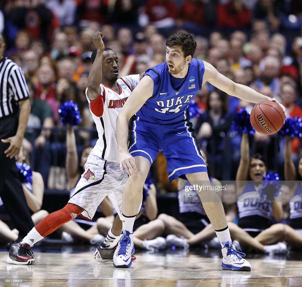Louisville guard Russ Smith (2) tries to stop Duke forward <a gi-track='captionPersonalityLinkClicked' href=/galleries/search?phrase=Ryan+Kelly+-+Basketspelare&family=editorial&specificpeople=15185169 ng-click='$event.stopPropagation()'>Ryan Kelly</a> (34) in second half action in the NCAA regional final game on Sunday, March 31, 2013, in Indianapolis, Indiana. Louisville won the game 85-63. (Sam Riche/MCT via Getty Images)in the NCAA regional final game on Sunday, March 31, 2013, in Indianapolis, Indiana. Louisville won the game 85-63.