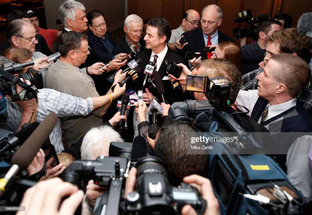 Louisville head coach and Naismith Memorial Basketball Hall of Fame honoree <a gi-track='captionPersonalityLinkClicked' href=/galleries/search?phrase=Rick+Pitino&family=editorial&specificpeople=210871 ng-click='$event.stopPropagation()'>Rick Pitino</a> (C) ) is interviewed at the Marriott Marquis on April 8, 2013 in Atlanta, Georgia.