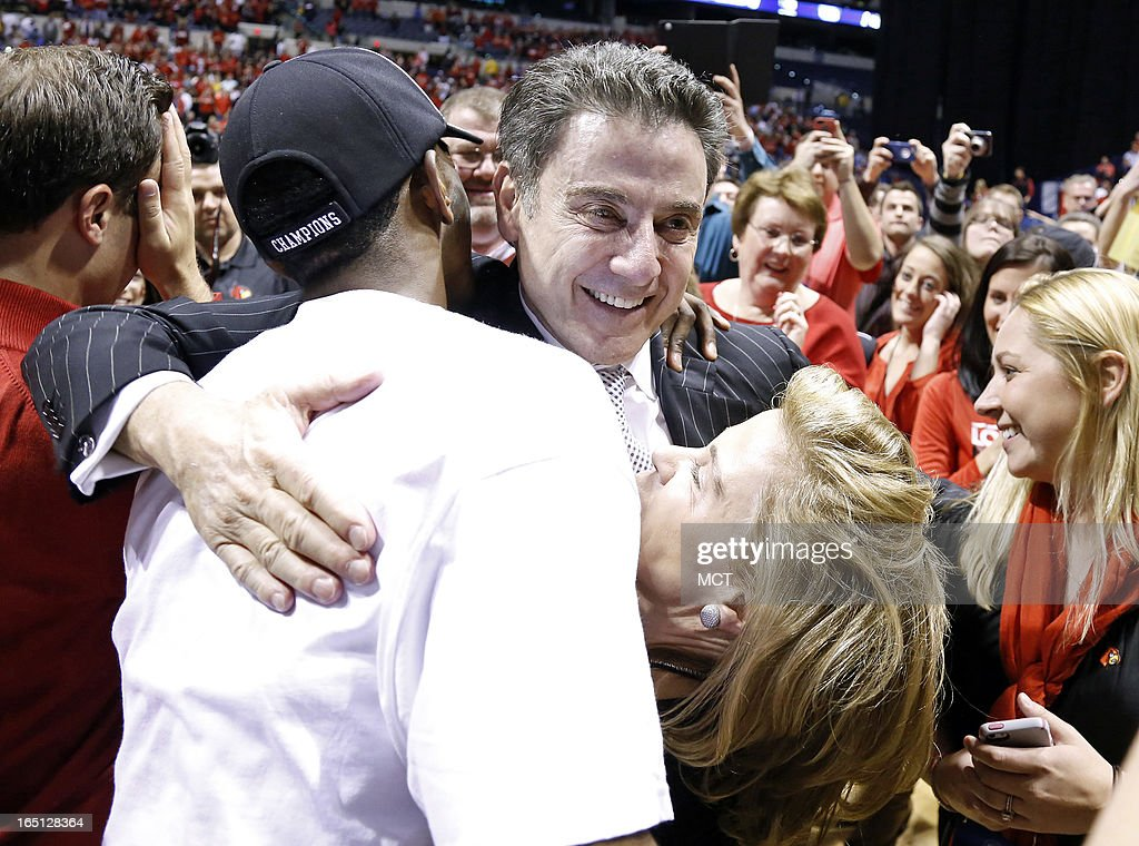 Louisville head coach Rick Pitino hugs Louisville guard Russ Smith (2) and his wife Joanne after their win in the NCAA regional final game on Sunday, March 31, 2013, in Indianapolis, Indiana. Louisville won the game 85-63. (Sam Riche/MCT via Getty Images)in the NCAA regional final game on Sunday, March 31, 2013, in Indianapolis, Indiana. Louisville won the game 85-63.