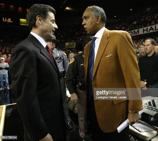 Louisville head coach Rick Pitino left and Kentucky head Coach Tubby Smith right talk before the University of Kentucky played the University of...