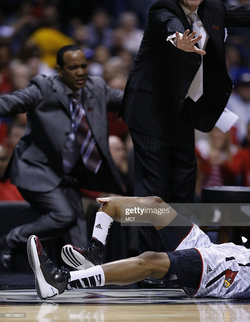 CONTENT*** Louisville team members rush off the bench as Louisville guard Kevin Ware has his right leg break in a gruesome accident after he tried to...