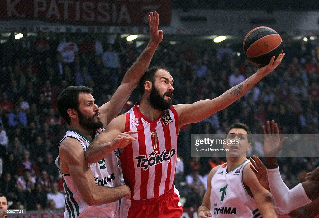 Loukas Mavrokefalides, #12 of Panathinaikos Athens competes with <a gi-track='captionPersonalityLinkClicked' href=/galleries/search?phrase=Vassilis+Spanoulis&family=editorial&specificpeople=704857 ng-click='$event.stopPropagation()'>Vassilis Spanoulis</a>, #7 of Olympiacos Piraeus during the 2013-2014 Turkish Airlines Euroleague Top 16 Date 14 game between Olympiacos Piraeus v Panathinaikos Athens at Peace and Friendship Stadium on April 10, 2014 in Athens, Greece.