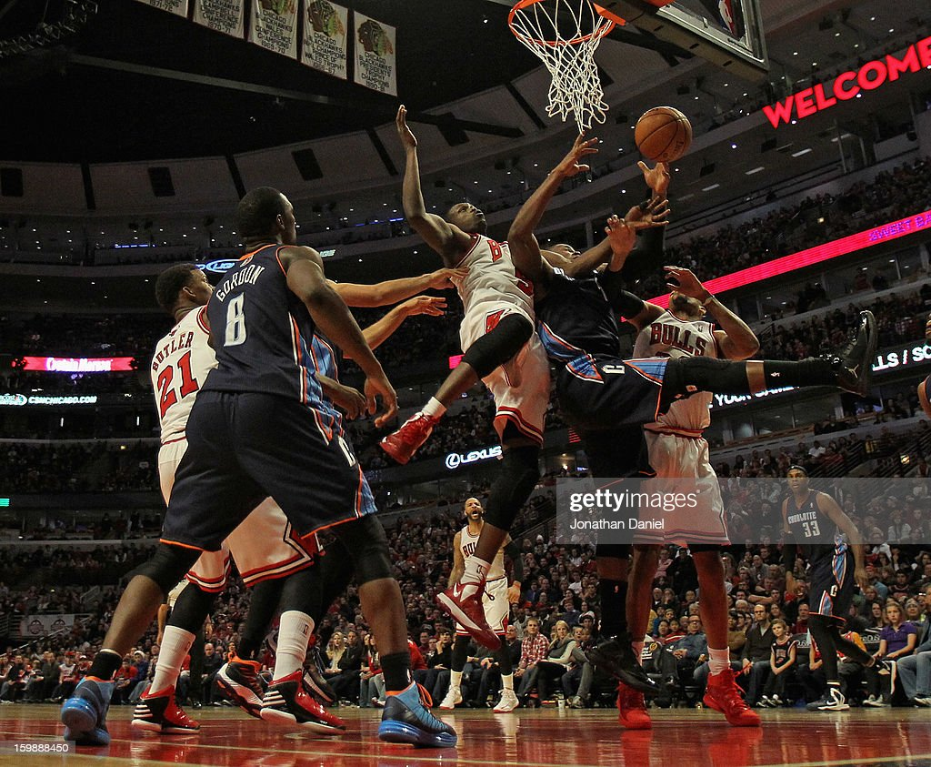 Loul Deng #9 of the Chicago Bulls and <a gi-track='captionPersonalityLinkClicked' href=/galleries/search?phrase=Jeff+Adrien&family=editorial&specificpeople=727235 ng-click='$event.stopPropagation()'>Jeff Adrien</a> #4 of the Charlotte Bobcats battle for the ball at the United Center on December 31, 2012 in Chicago, Illinois. The Bobcats defeated the Bulls 91-81.