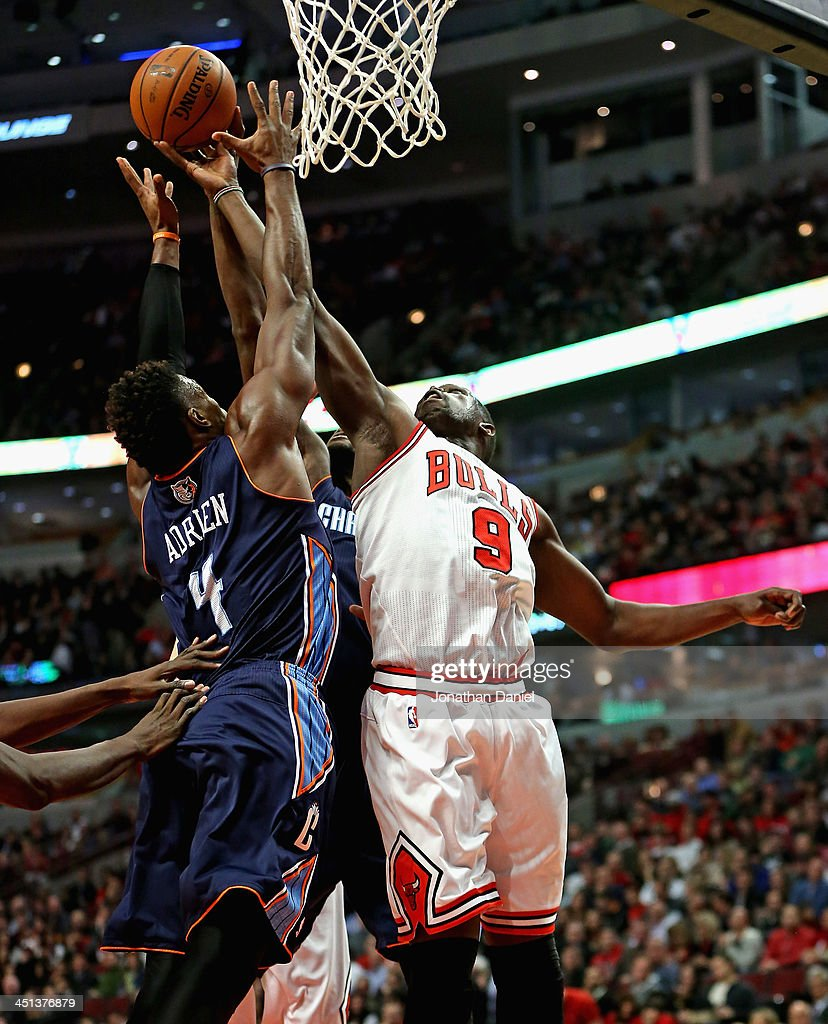 Loul Deng #9 of the Chicago Bulls and <a gi-track='captionPersonalityLinkClicked' href=/galleries/search?phrase=Jeff+Adrien&family=editorial&specificpeople=727235 ng-click='$event.stopPropagation()'>Jeff Adrien</a> #4 of the Charlotte Bobcats battle for a rebound at the United Center on November 18, 2013 in Chicago, Illinois. The Bulls defeated the Bobcats 86-81.