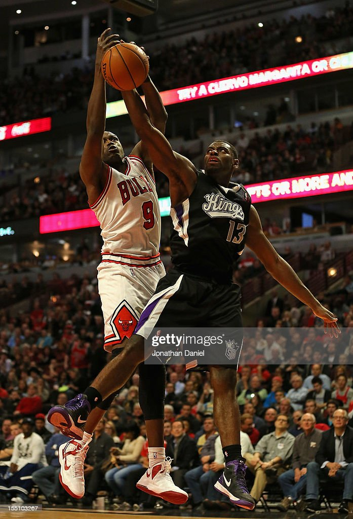 Loul Deng #9 of the Chicago Bulls battles for the ball with <a gi-track='captionPersonalityLinkClicked' href=/galleries/search?phrase=Tyreke+Evans&family=editorial&specificpeople=4851025 ng-click='$event.stopPropagation()'>Tyreke Evans</a> #13 of the Sacramento Kings at the United Center on October 31, 2012 in Chicago, Illinois. The Bulls defeated the Kings 93-87.