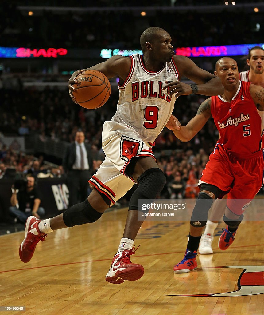 Loul Deng #9 of the Chicago Bulls drives past Caron Butler #5 of the Los Angeles Clippers at the United Center on December 11, 2012 in Chicago, Illinois. The Clippers defeated the Bulls 94-89.