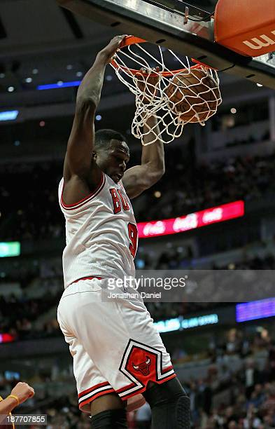 Loul Deng of the Chicago Bulls dunks against the Cleveland Cavaliers at the United Center on November 11 2013 in Chicago Illinois The Bulls defeated...