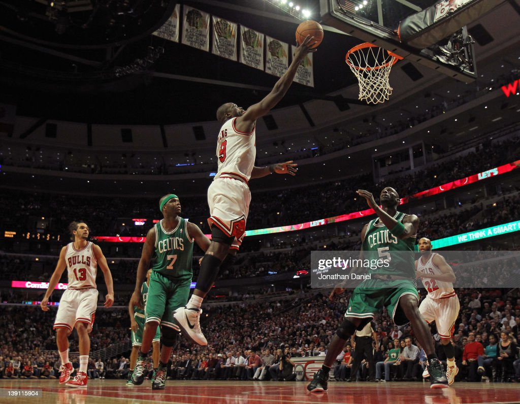 Loul Deng #9 of the Chicago Bulls goes up for a shot between <a gi-track='captionPersonalityLinkClicked' href=/galleries/search?phrase=Jermaine+O%27Neal&family=editorial&specificpeople=201524 ng-click='$event.stopPropagation()'>Jermaine O'Neal</a> #7 and <a gi-track='captionPersonalityLinkClicked' href=/galleries/search?phrase=Kevin+Garnett&family=editorial&specificpeople=201473 ng-click='$event.stopPropagation()'>Kevin Garnett</a> #5 of the Boston Celtics on his way to 23 points at the United Center on February 16, 2012 in Chicago, Illinois. The Bulls defeated the Celtics 89-80.